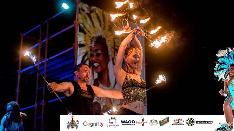 Duo fire performance on stage at a carnival themed event in Kitwe, Zambia. www.enchantedbychrista.co.za