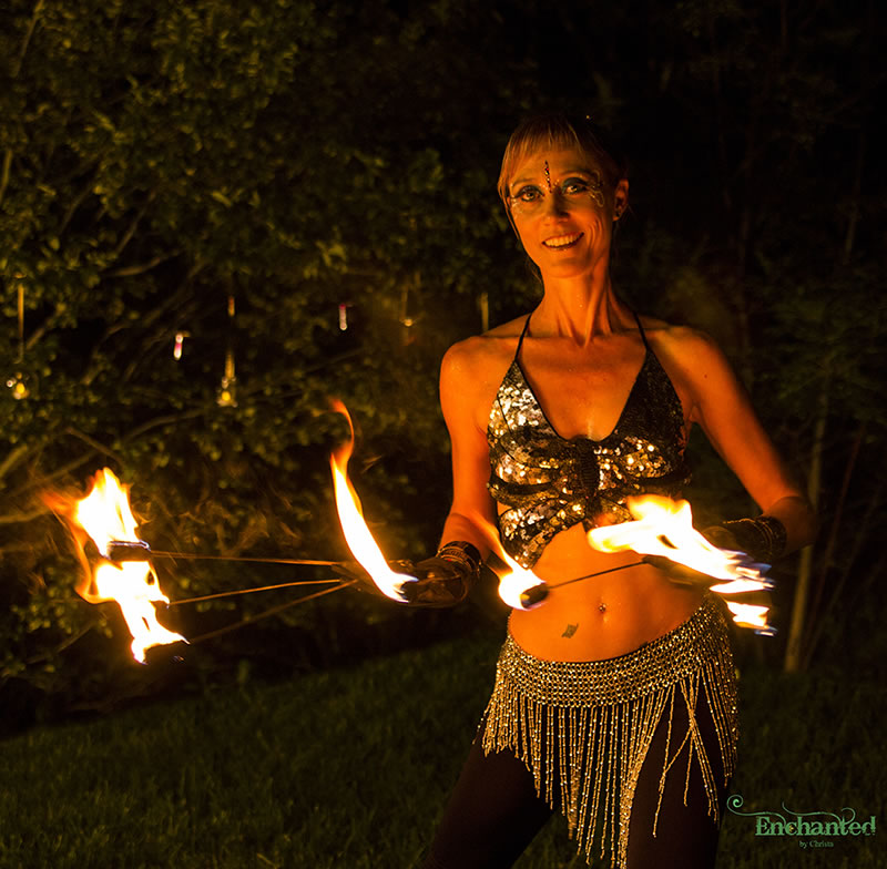 These fire fingers always gets the audiences' attention because they are so different and the fire dancer can get really close up her crowd. www.enchantedbychrista.co.za