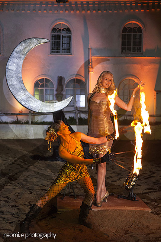 In this corporate show piece combo, you can see a fire performer and a Saxophonist perform together. www.enchantedbychrista.co.za