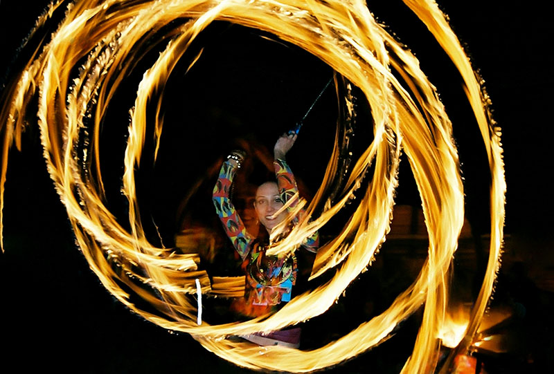 Big circles of fire created around the fire dancer with fire poi. www.enchantedbychrista.co.za