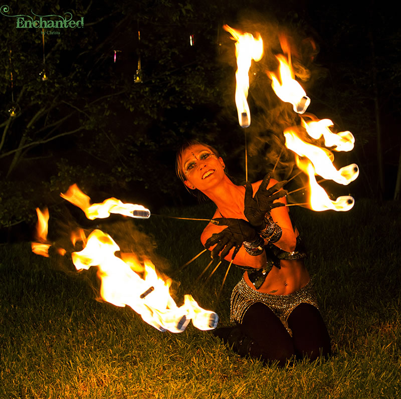 These fire fingers are gloves worn by the fire dancer. The result is a very graceful fire performance because it is like having flames at the end of her own fingers. www.enchantedbychrista.co.za
