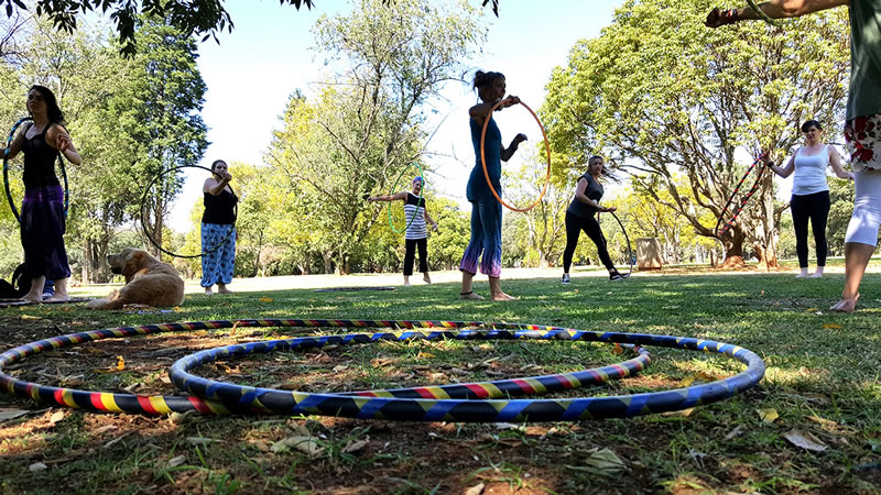 a hooping workshop where practice hula hoops are provided. www.enchantedbychrista.co.za