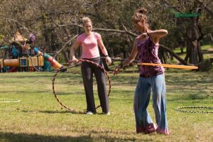 Christa teaching a participant of her workshop a hooping trick. www.enchantedbychrista.co.za