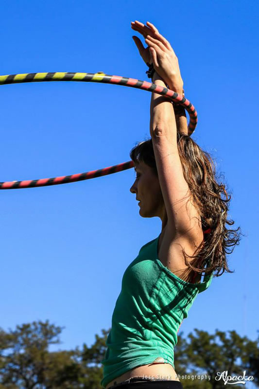 Graceful hoop dancer performing during the day. www.enchantedbychrista.co.za