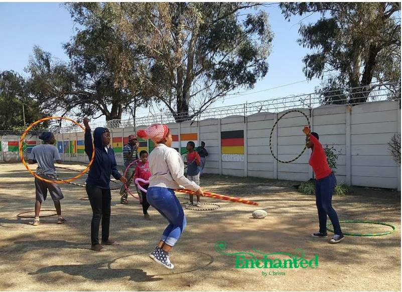 Kids playing hooping games at a charity day at Kids Haven in Johannesburg. www.enchantedbychrista.co.za