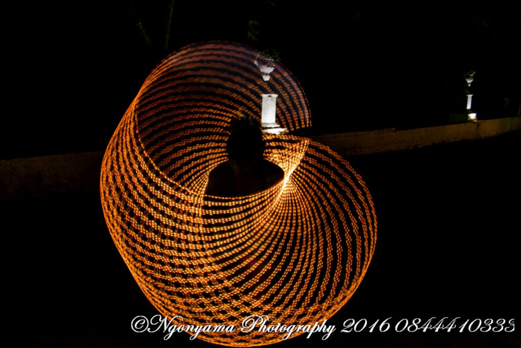 Golden circular pattern creating a golden ball around the LED hula hoop performer. www.enchantedbychrista.co.za