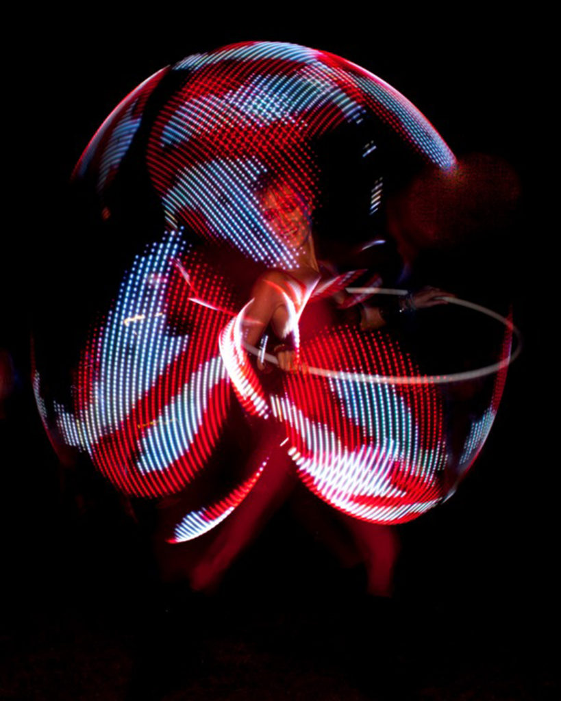 Red and white Ghostbusters pattern displayed around a hula hoop dancer. www.enchantedbychrista.co.za