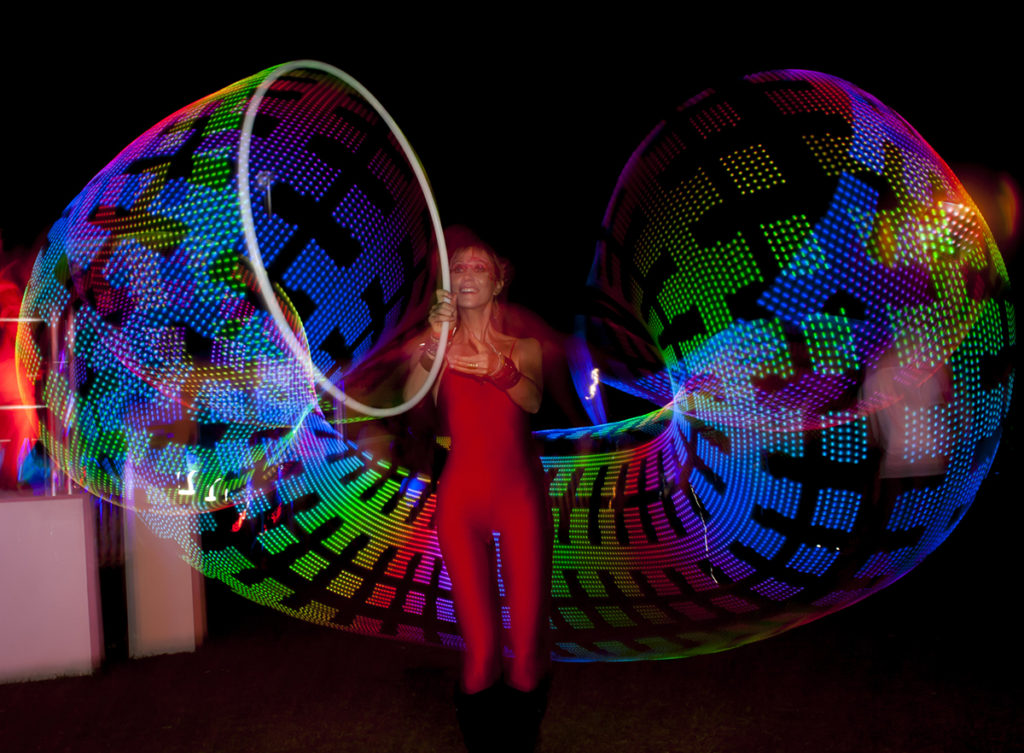 a striking circular pattern created around a LED hula hoop dancer at Ultra Festival, South Africa. www.enchantedbychrista.co.za