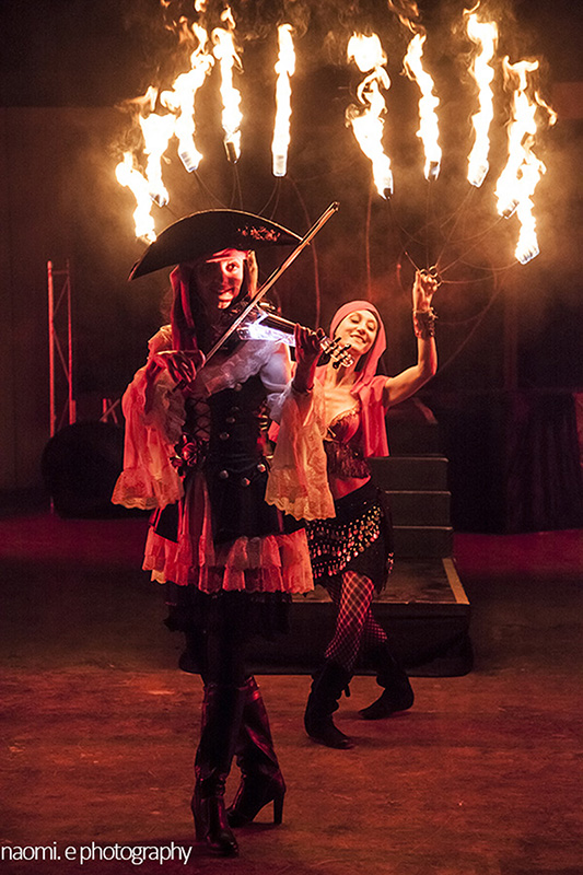 a fire fan performance accompanied by a violinist for a pirate theme corporate showpiece. www.enchantedbychrista.co.za