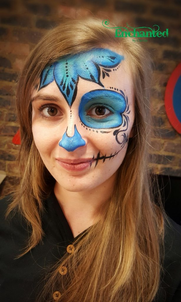 Sugar skull face painting design to match a Day of the Dead theme office party in Johannesburg