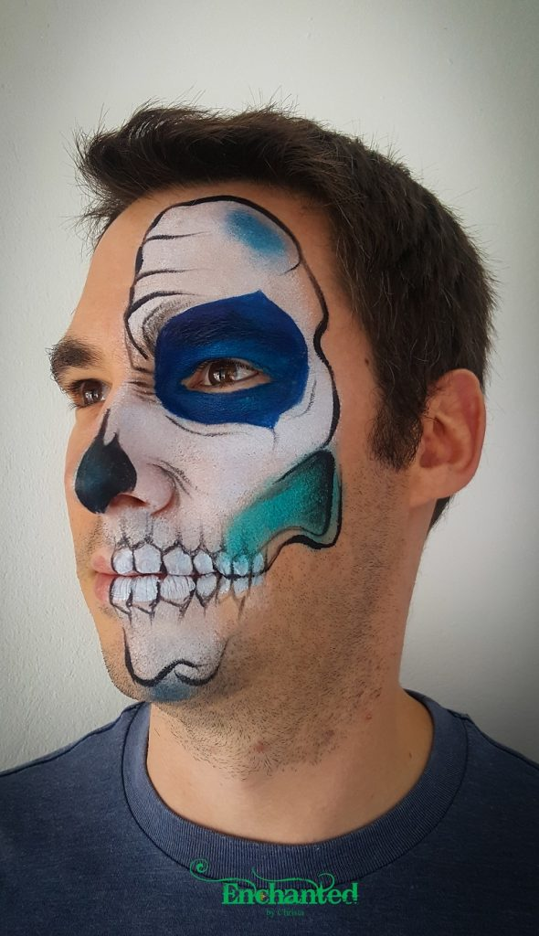 This half skull Halloween face paint design for men is always a hit and doesn't take that long to paint
