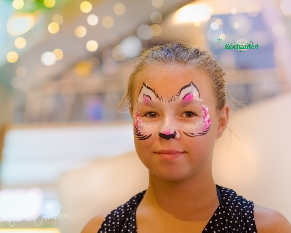 This is my simplified cat face paint design with flowers incorporated into the design