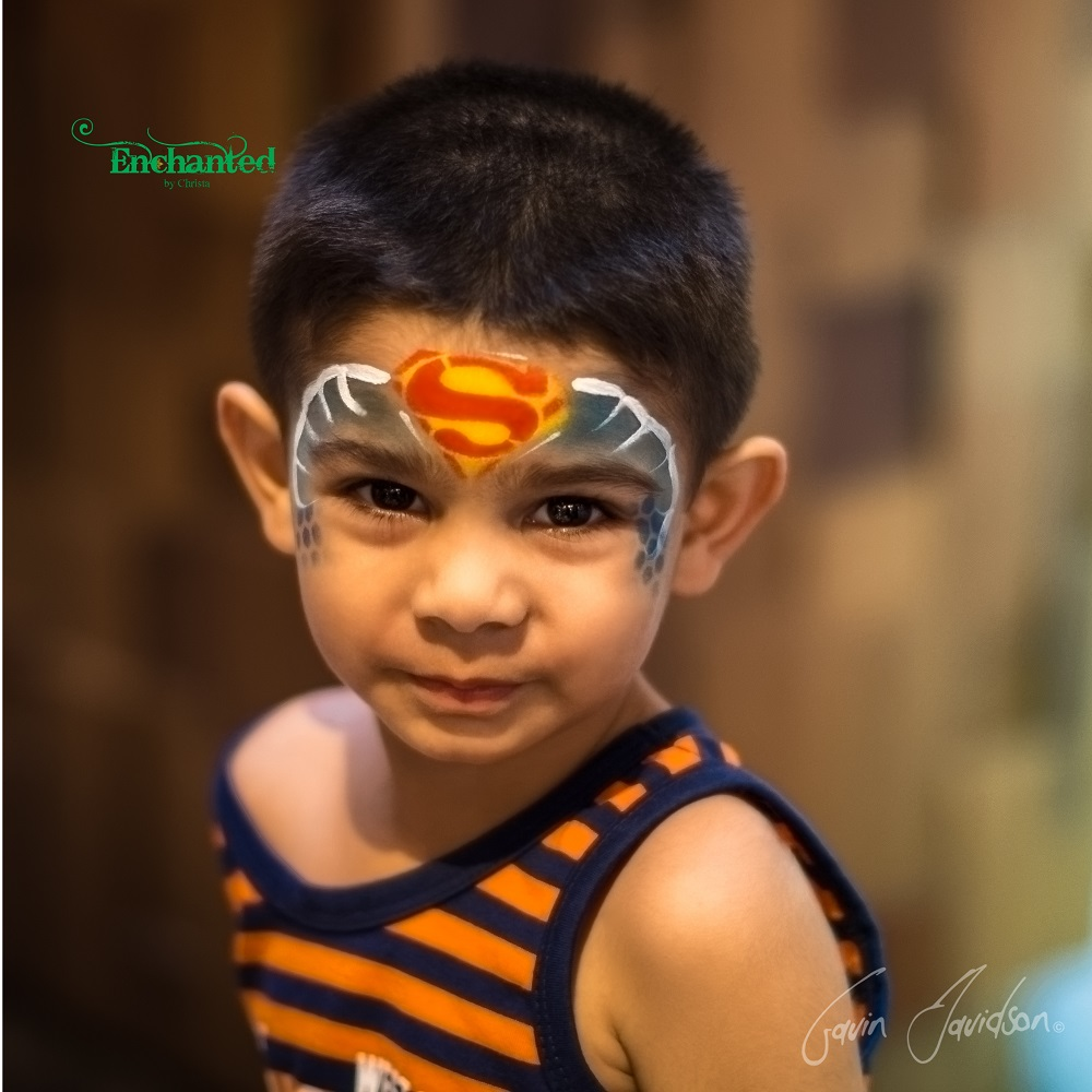 Boys love having this Superman face paint design painted on their faces.