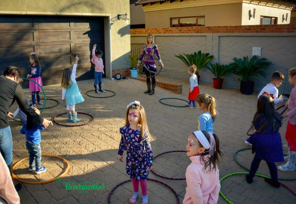 Musical hula hoops is one of the games that we play with kids at a hula hooping party