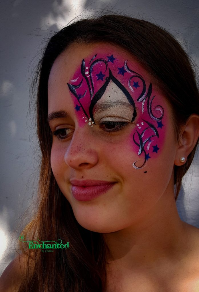 a sophisticated Spidergirl face paint design around one eye with stars works well for older kids and teenagers