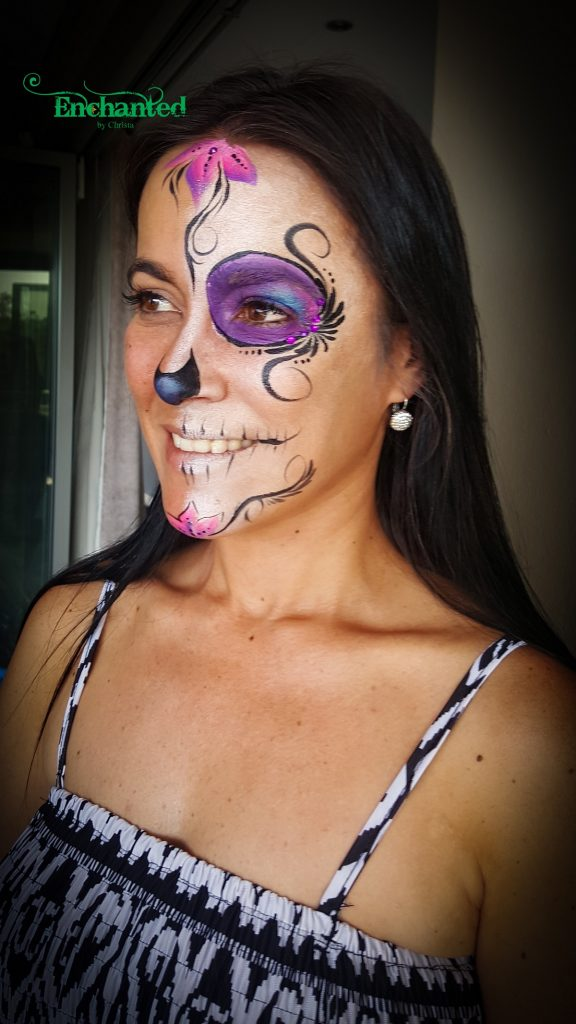a half face Sugar Skull design looks very effective and is quick to execute if the face painter has limited time available.