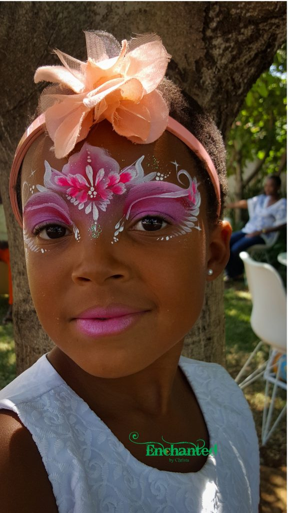 This pretty princess face paint design in shades of pink is always a hit