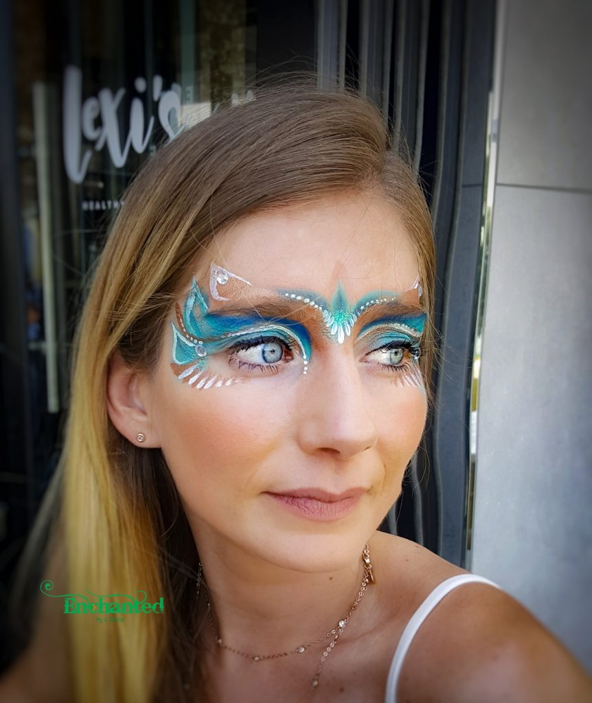 Face painting at festivals are very popular where ladies get colourful designs painted either on the side of the eye or around both eyes like in this picture