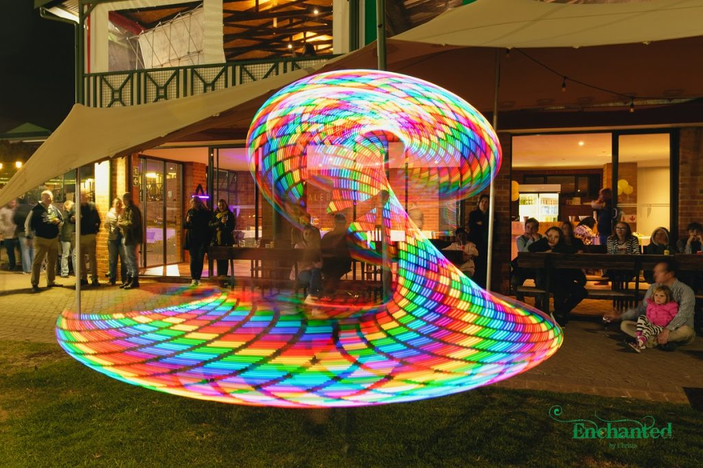 Rainbows swirls created by a LED hula hoop during a performance at a 13th birthday party