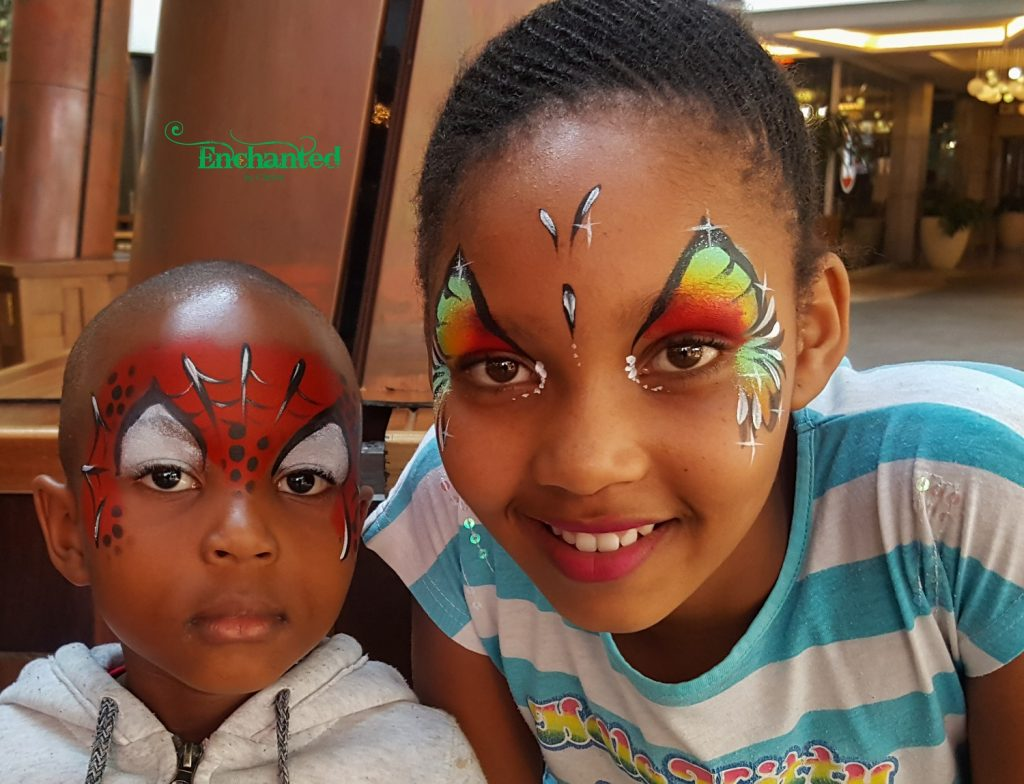 This photo was taken at SunCity and shows a butterfly and a Spiderman face paint designs which are two of the most popular face paint designs for kids.