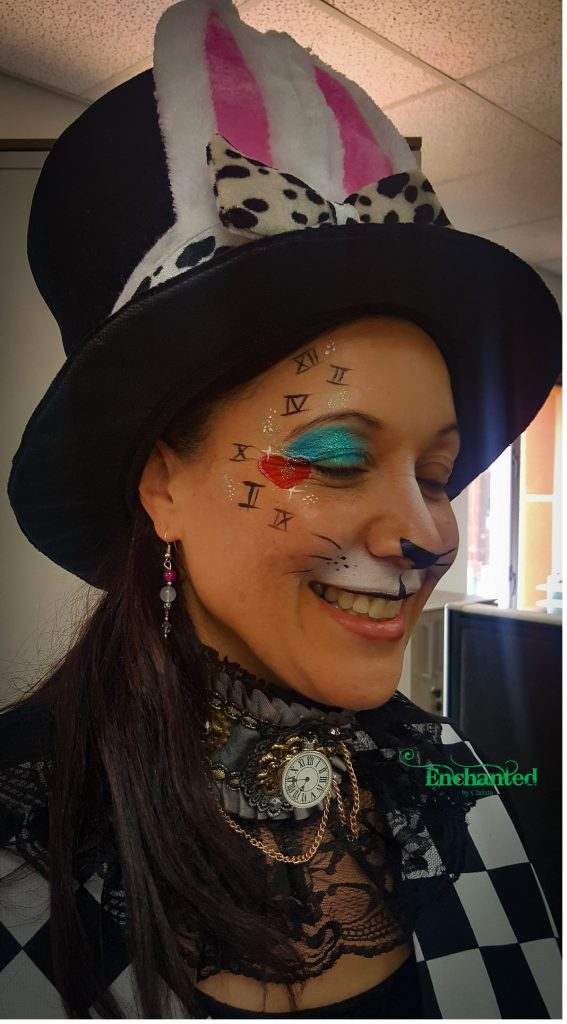 a face paint design around the eye of an adult lady to match Alice in Wonderland theme.