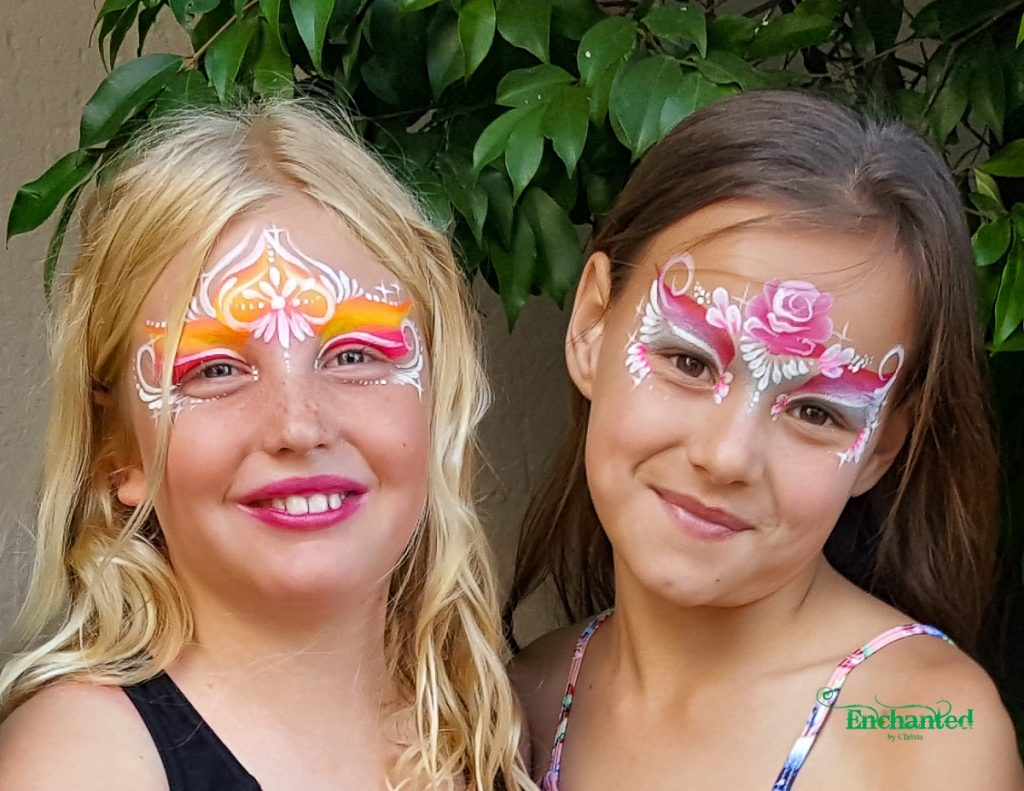Two princess face paint designs, one in shades of pink with a rose and the other painted with neon face paint