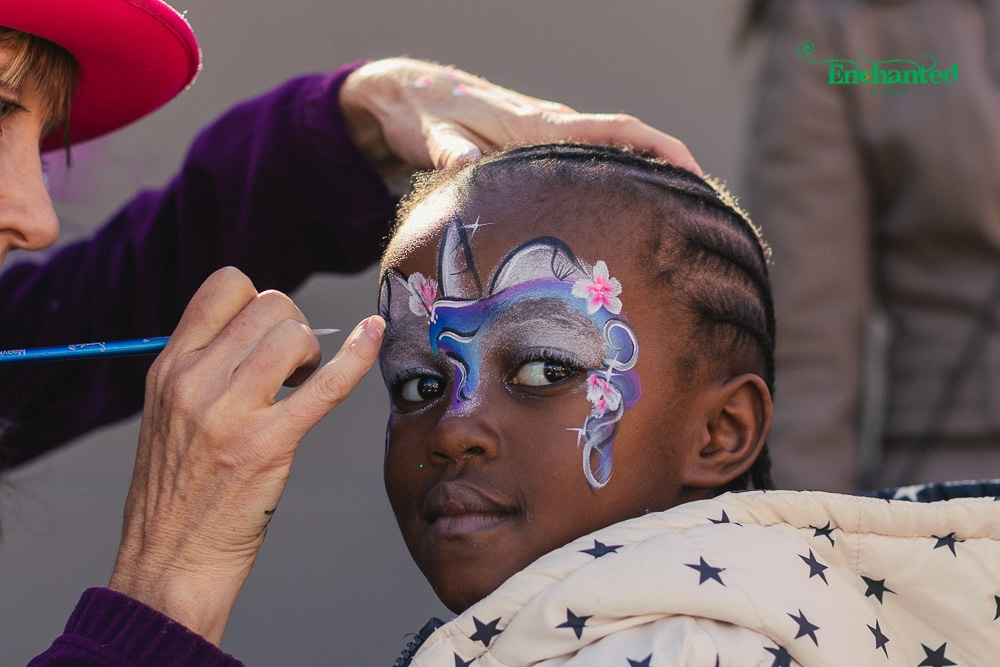 Christa at work face painting a unicorn face paint design. The picture was taken by our professional birthday photographer at a party in Johannesburg. We offer photographic and face painting packages for birthday parties in Gauteng