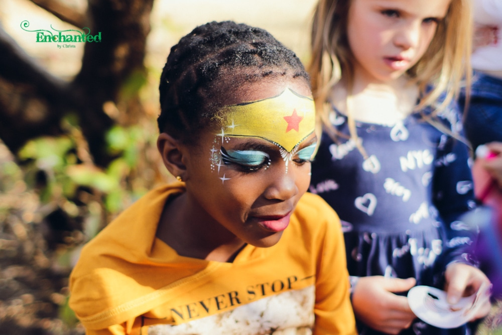 Older girls love this Wonder women face paint design in blue and gold