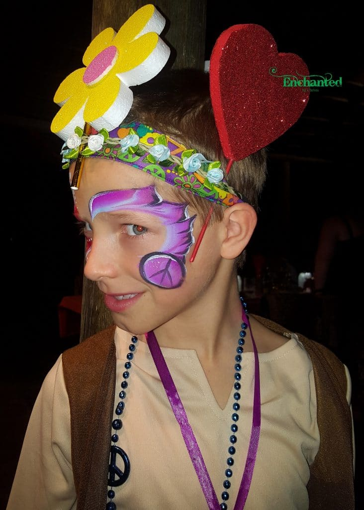 a purple design with a peace sign incorporated into the design fitted the 60's themed event