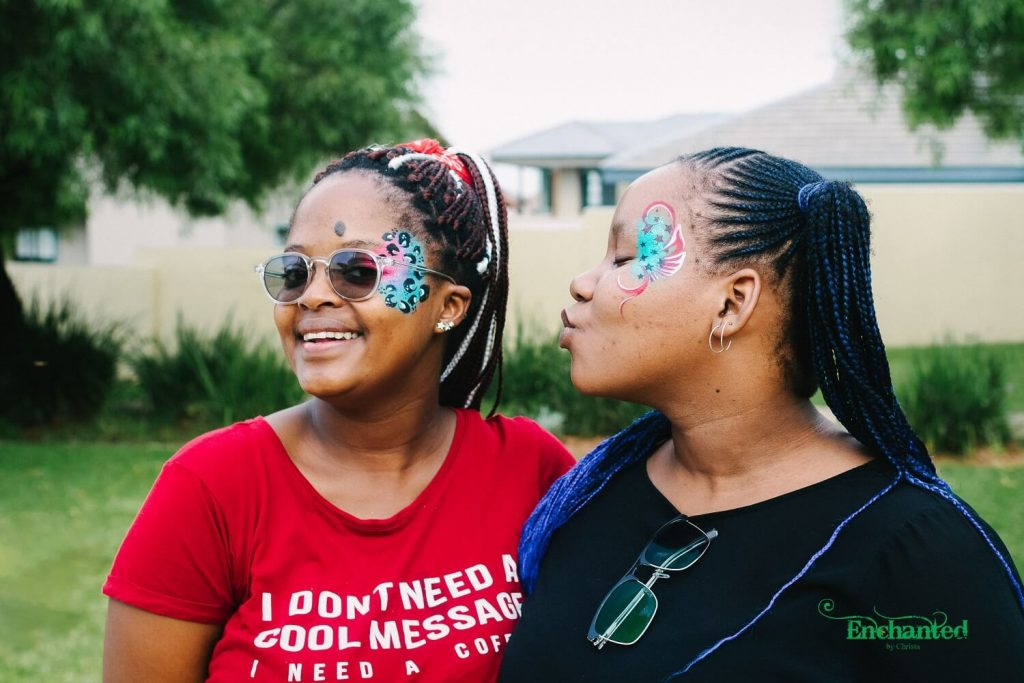Our photographer captured these two with their stylish face paint designs for adults