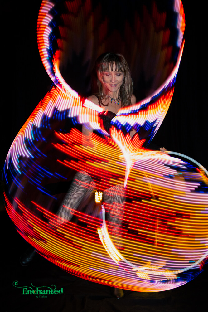 Add a wow factor to your next year end function with a LED hula hoop performance.