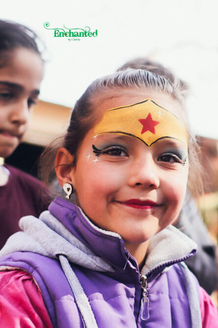 This Wonder Woman face paint in blue, gold and red is a great design for girls who like superheroes