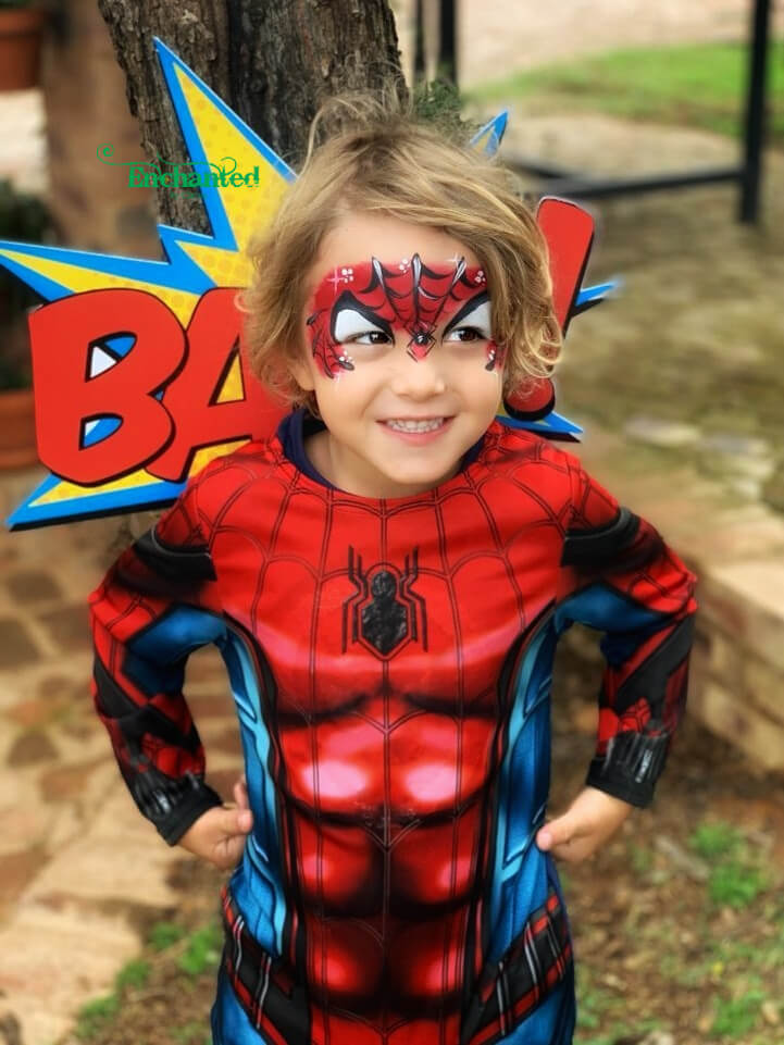 This Spiderman face paint design matches this boys Spiderman outfit