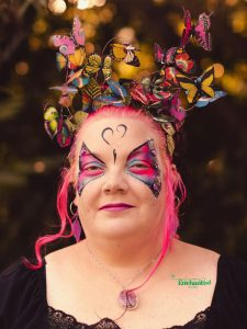 pink butterfly face paint design to match a butterfly themed 40th birthday party