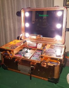 Rosewood colour face painting case with mirror, lights and sections that fold out
