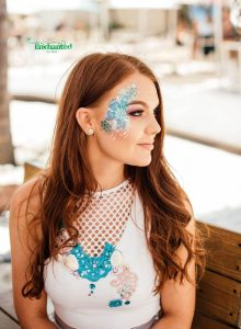 This seashell design on the side of the face is a great idea for women's face painting