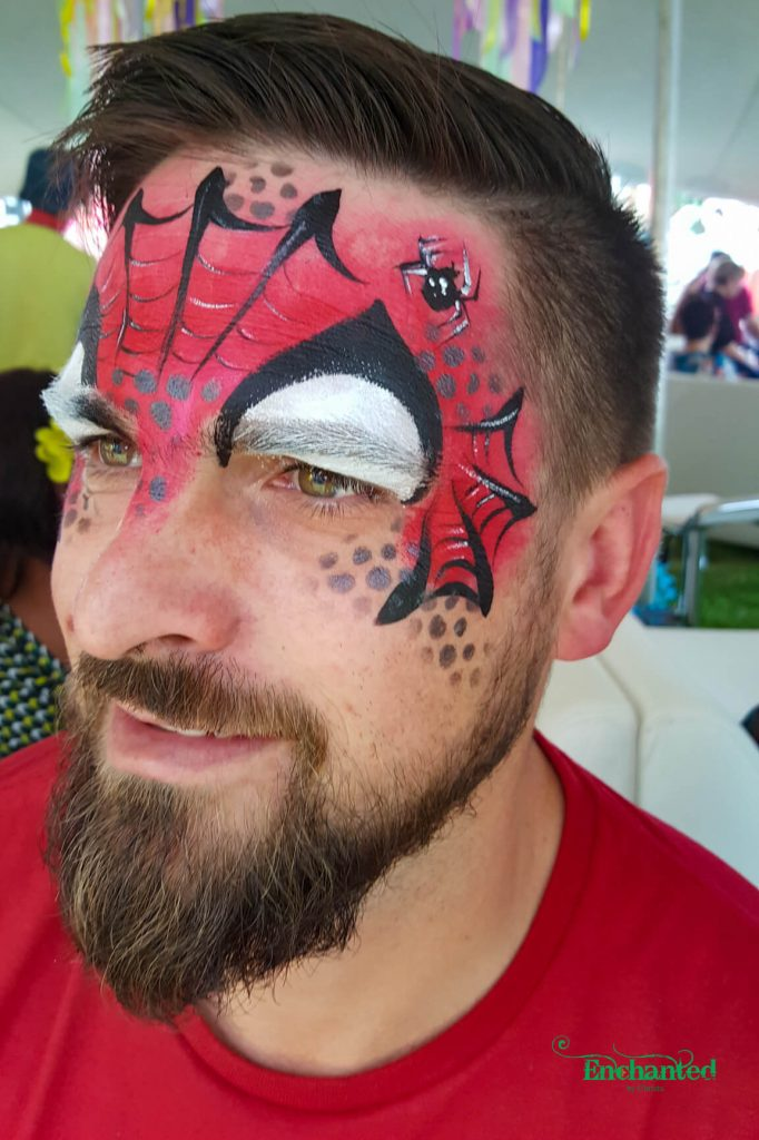 This cool Spiderman face paint design works perfectly for an adult face as well