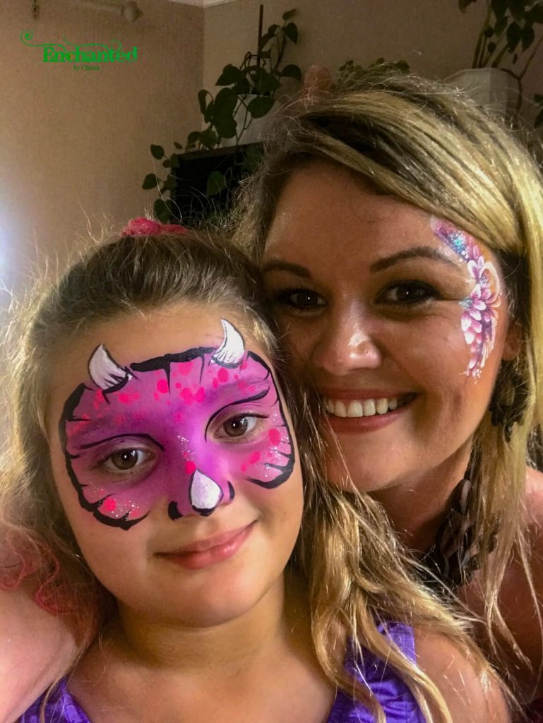 This pink dinosaur face paint design will make any girl happy